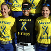 Danvers: Danvers senior captain Chrissy Gikas, Beverly senior captain Natalie Shea, and Danvers sophomore Brittany Dougal, pose for a post-game photo as both teams sported special jerseys in support of The One Fund. David Le/Salem News