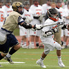 Beverly: Beverly senior Ryan Shipp avoids a crosscheck from a Malden Catholic defender on Saturday afternoon. David Le/Salem News