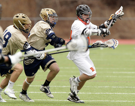 Beverly: Beverly midfielder Jordan Rawding, right, holds the ball out of the reach of two Malden Catholic players as he maneuvers through the offensive zone. David Le/Salem News