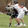 Beverly: Beverly sophomore attack Nick Albano checks a Malden Catholic player hard as he tries to create a turnover during the first half of play on Saturday afternoon. David Le/Salem News