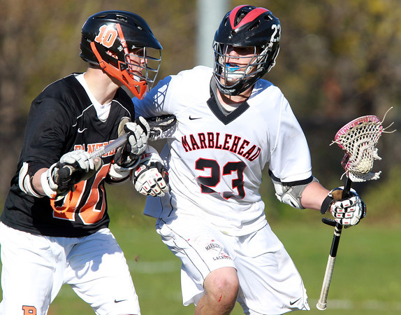Marblehead: Marblehead senior midfielder Ian Maag shields the ball while being closely pursued by Beverly senior Dave Rollins on Tuesday afternoon. David Le/Salem News