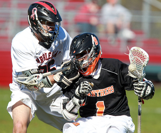 Marblehead: Beverly attack Ryan Shipp, right, tries to get past Marblehead midfielder Ben Anderson, left, on Tuesday afternoon. David Le/Salem News