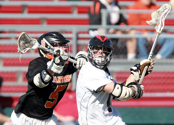 Marblehead: Marblehead midfielder Brooks Tyrrell winds up to take a shot as Beverly midfielder Dom Abate closes in and disrupts Tyrrell's shot. David Le/Salem News