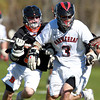 Marblehead: Marblehead midfielder Matt Dicenso, right, looses control of the ball while being checked by Beverly midfielder Dom Abate, left, during the first quarter of play on Tuesday afternoon. David Le/Salem News