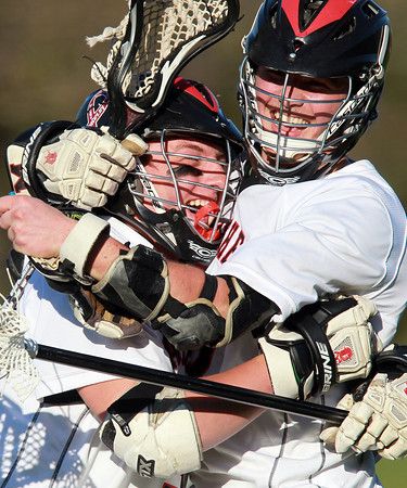 Marblehead: Marblehead senior Zac Cuzner, right, gets a big hug from teammate Liam Gillis after the Magicians pulled out a 5-4 win over NEC rivals Beverly on Tuesday afternoon. David Le/Salem News