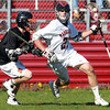 Marblehead: Marblehead senior Ian Maag shields the ball and runs past Beverly defenseman Bryan Flaherty, left, during the third period of play on Tuesday afternoon. The Magicians led by three third quarter goals from Trevor Jones, defeated NEC rival Beverly 5-4 at Piper Field in Marblehead. David Le/Salem News