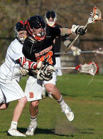 Marblehead: Beverly senior Brendan Flaherty, right, shields the ball while fending off a check from Marblehead junior Dean Fader, left, during the 4th quarter of play on Tuesday afternoon. David Le/Salem News