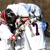 Marblehead: Marblehead senior midfielder Ian Maag jumps on a few of his teammates after teammate Trevor Jones scored his third straight goal, giving the Magicians a 3-2 lead over Beverly. Jones scored Marblehead's first four goals, propelling them to a 5-4 win over their NEC rivals on Tuesday afternoon at Piper Field in Marblehead. David Le/Salem News
