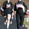 Marblehead: Beverly junior Mary Cate Flaherty sprints to the finish line, out-kicking Marblehead junior Paige Ferrucci, left, on Wednesday afternoon. David Le/Salem News