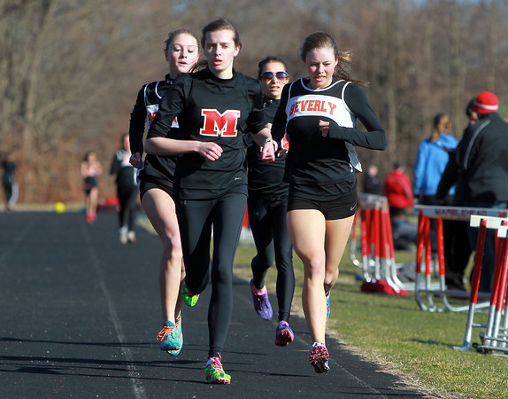 Marblehead: From left, Beverly junior Jess Goodall, Marblehead sophomore Anna Barrell, Marblehead freshman Sarah Oliver, and Beverly junior Keely Higgins run in a tight pack during the girls mile race on Wednesday afternoon. David Le/Salem News