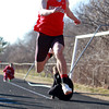 Marblehead: Marblehead senior Josh Beloff soars in the air during the triple jump. David Le/Salem News