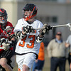 Beverly: Beverly senior midfielder Brendan Flaherty rifles a shot past Marblehead goalie Nathan Maselek for one of his two goals on the afternoon as the Panthers downed the Magicians 12-6. David Le/Salem News