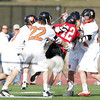 Beverly: Marblehead junior Dean Fader gets in the middle of a scrum with a pack of Beverly players early in the third quarter of play. Fader and Beverly senior Dave Rollins were ejected from Tuesday afternoon's NEC matchup after a fight broke out between the two teams. David Le/Salem News