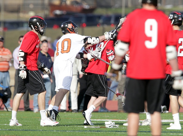 Beverly: Beverly senior Dave Rollins cross-checks Marblehead's Dean Fader which started a multi-player brawl early in the third quarter of play. Rollins and Fader were both ejected for throwing punches. David Le/Salem News