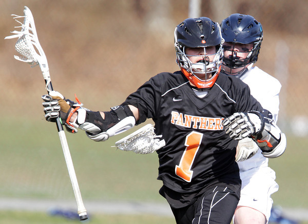 Peabody: Beverly senior attack Ryan Shipp protects the ball while being stick-checked by a Peabody defenseman on Wednesday afternoon. David Le/Salem News