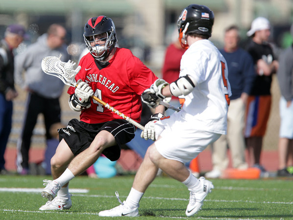 Beverly: Marblehead sophomore Brooks Tyrrell, left, tries to get past Beverly senior Dom Abate during the first half of play on Tuesday afternoon. David Le/Salem News