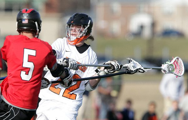 Beverly: Beverly defense ____ Jutras, right, tries to get a shot off while being bothered by Marblehead's Alex Conn, left, on Tuesday afternoon. David Le/Salem News