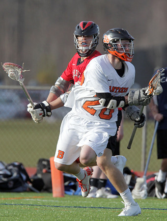 Beverly: Beverly senior Conor Leahy goes airborne after getting tangled up with Marblehead senior Ian Maag on Tuesday afternoon. David Le/Salem News