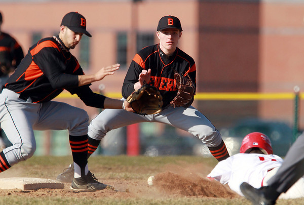 Topsfield: Beverly shortstop Anthony DiOrio, left, and second baseman Alex Toomey, try to make a play on the baseball as it hits sliding Masco baserunner Speros Varinos on a first inning steal attempt at second base. David Le/Salem News