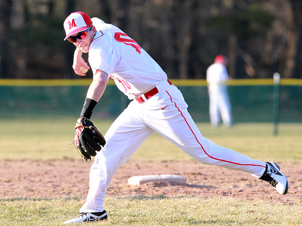 Topsfield: Masco's Dan Dempsey makes an off balance throw to first base to nail a hustling Beverly runner. David Le/Salem News