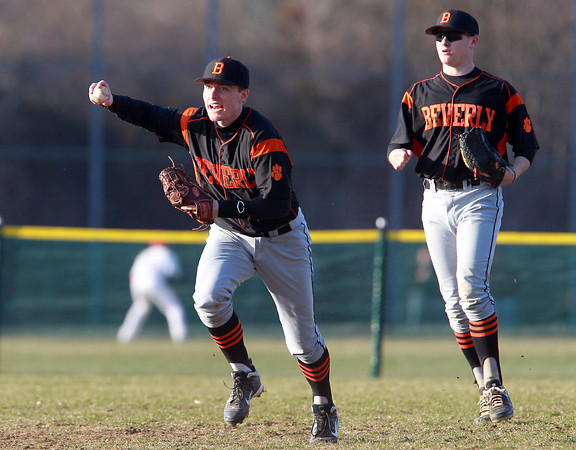Topsfield: Beverly second baseman Alex Toomey, left, runs the ball back into the infield to tag second base and double up a Masco runner as center fielder Harry Brown looks on. David Le/Salem News
