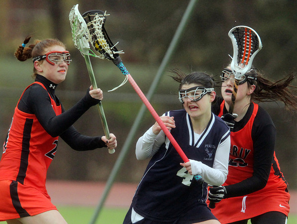 Beverly: Peabody's Mikayla York, center, looks to maintain possession of the ball while being pressured by Beverly's Rose Terner, left, and Becca Salah, right, on Friday afternoon. David Le/Salem News