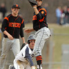 Peabody: Beverly shortstop Anthony DiOrio, right, holds up the baseball for the umpire to see, but Peabody's Matthew McIsaac kneels safely on second base after a successful steal attempt. David Le/Salem News