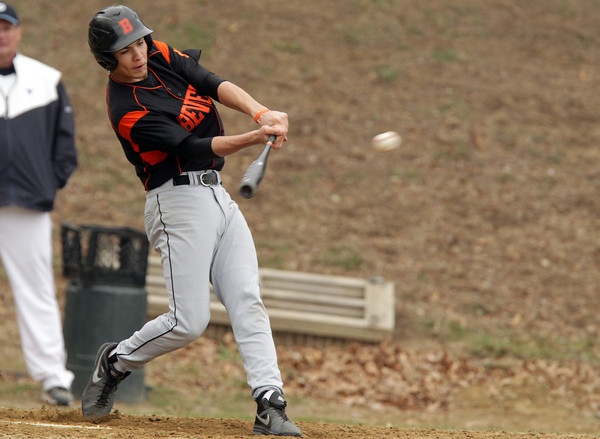 Peabody: Beverly junior first baseman John Berchoff lines a double off Peabody starting pitcher Pat Ruotolo on Wednesday afternoon. David Le/Salem News