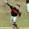 Peabody: Beverly third baseman George Hillois fires the ball to first to throw out a Peabody runner. David Le/Salem News
