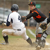 Peabody: Beverly third baseman George Hillois tags out Peabody runner Matthew McIsaac after he got in a rundown between home and third. David Le/Salem News