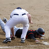 Peabody: Beverly senior Cam Rogers slides safely back into first base ahead of the tag from Peabody's Frank Lowry. David Le/Salem News