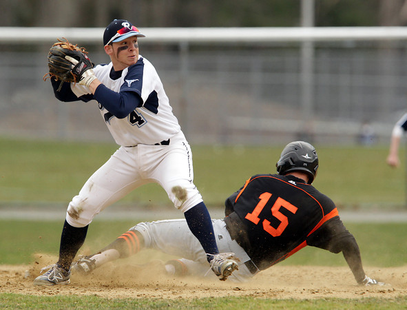 Peabody: Peabody second baseman Matthew McIsaac fires the ball to first on a doubleplay attempt around Beverly's Harry Brown as he slides into second base trying to break up the play. David Le/Salem News