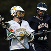Peabody: Bishop Fenwick's Troy Reinold, protects the ball while being stick checked by North Shore Tech'sSean McDonough, on Friday evening. David Le/Salem News