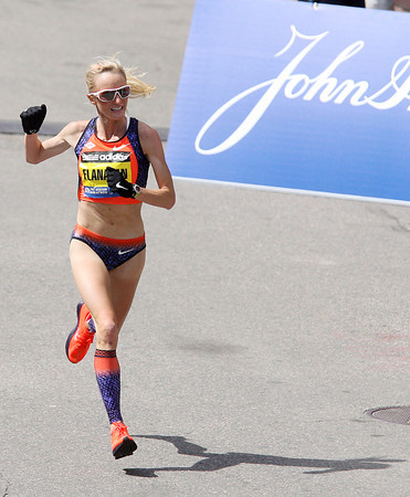 Boston: Marblehead native Shalane Flanagan pumps her fist as she runs down the straightaway of the 117th Boston Marathon on Monday afternoon. Flanagan finished 4th overall in the Women's Elite race in a time of 2:27:08. David Le/Salem News