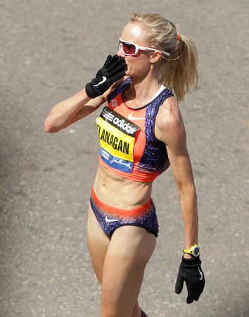 Boston: Marblehead native Shalane Flanagan blows a kiss to the crowd after crossing the finish line of the 117th Boston Marathon on Monday afternoon. David Le/Salem News