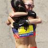 Boston: An emotional Shalane Flanagan hugs American teammate Kara Goucher after they finished the 117th Boston Marathon on Monday afternoon. David Le/Salem News