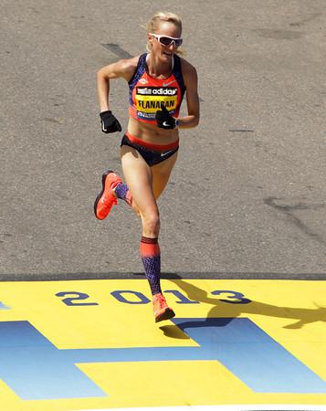 Boston: Marblehead native Shalane Flanagan crosses the finish line of the 117th Boston Marathon on Monday afternoon. David Le/Salem News