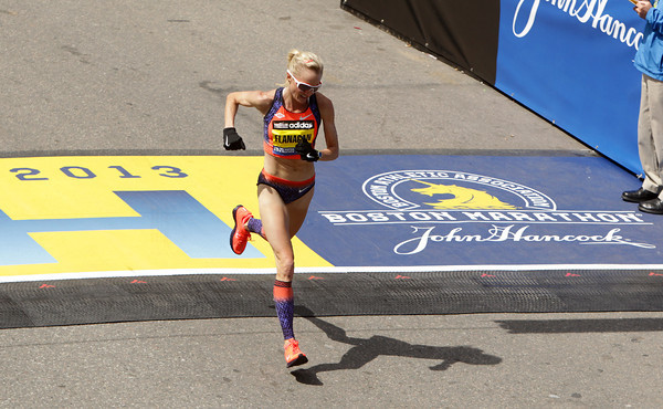 Boston: Marblehead native Shalane Flanagan crosses the finish line of the 117th Boston Marathon on Monday afternoon. David Le/Salem News