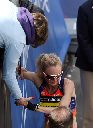 Boston: An emotional Shalane Flanagan talks with her mom who was sitting in the stands next to the finish line of the 117th Boston Marathon. David Le/Salem News