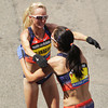 Boston: An emotional Shalane Flanagan hugs American teammate Kara Goucher after both had finished the 117th Boston Marathon. David Le/Salem News