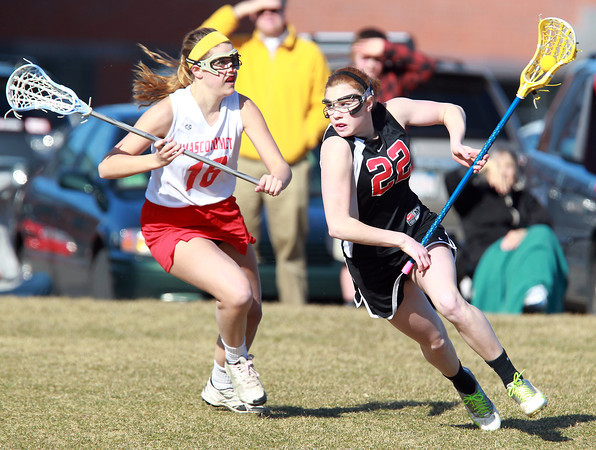 Topsfield: Marblehead's Tyler Phillips, right, drives past Masco's Becca Phillips, left, on Thursday afternoon. David Le/Salem News