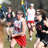 Boxford: Masco midfielder Kathleen Gillespie carries the ball up-field while being pursued by Marblehead's Meggie Collins. David Le/Salem News
