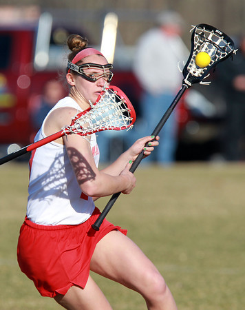 Topsfield: Masco attack Amy Arnold looks for room to get a shot off against Marblehead on Thursday afternoon. David Le/Salem News