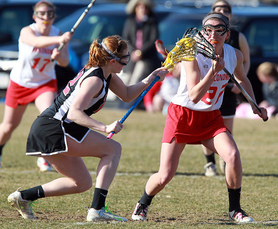 Topsfield: Marblehead's Tyler Phillips and Masco's Kathleen Gillespie battle on the face-off draw. David Le/Salem News