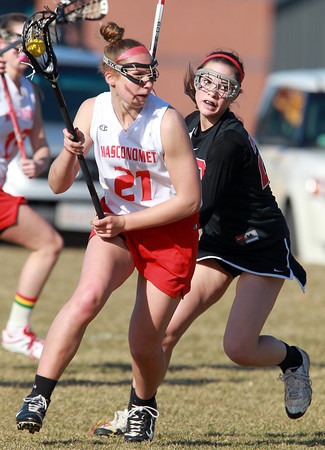 Topsfield: Masco attack Amy Arnold looks to get past Marblehead junior Caroline Helmes on Thursday afternoon. David Le/Salem News