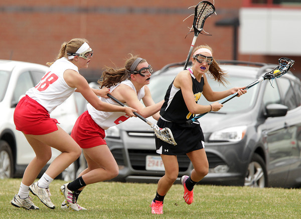 Topsfield: Bishop Fenwick junior Natalie Emerson, right, and the Crusaders couldn't get past the stifling defense from Masco led by midfielders Becca Phillips, left, and Kathleen Gillespie, falling 18-6 to the Chieftans on Tuesday afternoon. David Le/Salem News