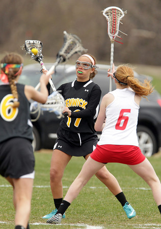 Topsfield: Bishop Fenwick junior Vicky Caruso, looks to make a pass to teammate Grace Celona, left, while being defended by Masco's Abby Reblin, right, on Tuesday afternoon. David Le/Salem News