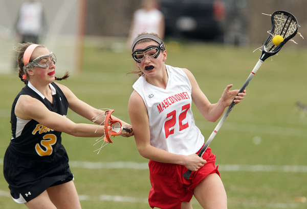 Topsfield: Masco midfielder Kathleen Gillespie, right, lines up a shot on net while being pressured by Bishop Fenwick defense Jackie Hart, left, on Tuesday afternoon. David Le/Salem News