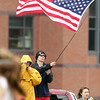 Topsfield: Masco senior Luke Schell flies an American flag at the Masco-Bishop Fenwick girl's lacrosse game on Tuesday afternoon. David Le/Salem News