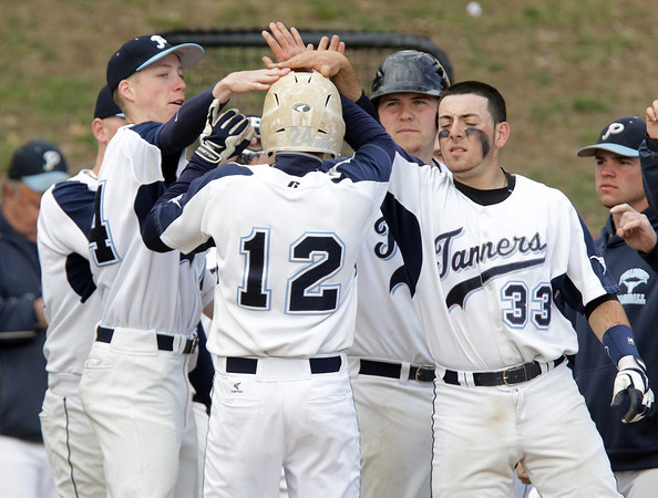 Peabody: Peabody players congratulate teammate Mike Petrosino, center, after he scored the only run of the game against Marblehead on Friday afternoon. Peabody senior Pat Ruotolo went the distance for the Tanners while striking out 13 Magicians batters.David Le/Salem News